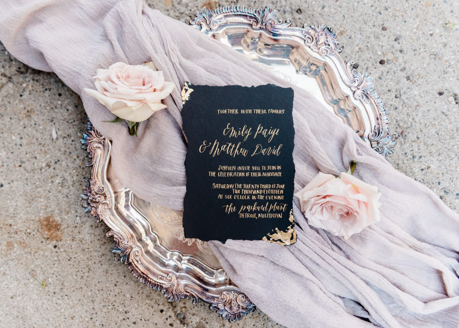 Oh Eleven Calligraphy   black invitation with metallic gold ink and gold foiled edges.