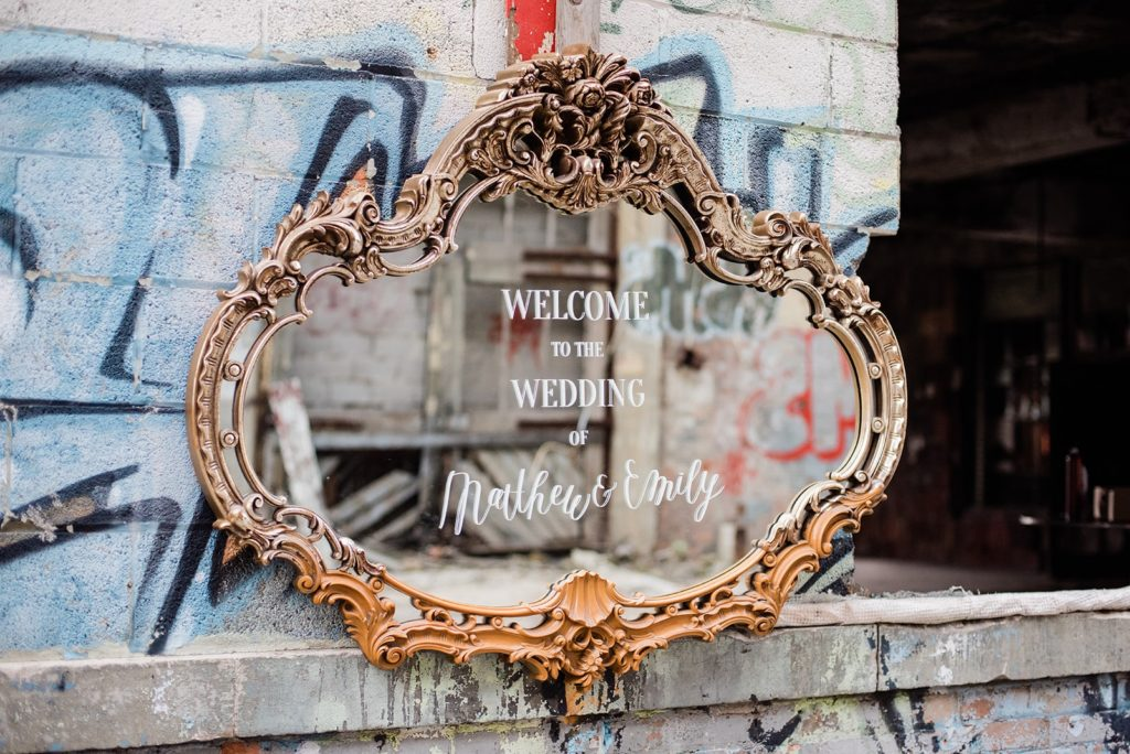 Mirror with modern calligraphy and typography located in abandoned factory.